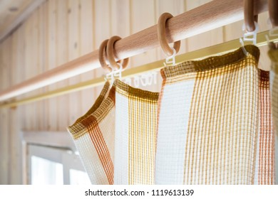 Cornice and curtains in a country house on a background of the walls and windows. Close-up.