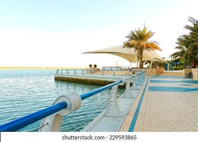 Corniche Road, Abu Dhabi, United Arab Emirates - November, 2014: Corniche Road is a major road in Abu Dhabi with many beautiful sceneries by the sea.