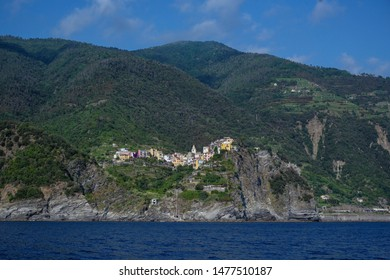Corniglia with colorful houses, a Cinque Terra mountain village and tourist attraction on the steep coast of the Mediterranean sea in Liguria, Italy, copy space