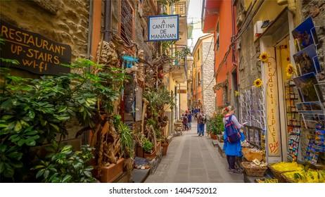 CORNIGLIA, ITALY - NOVEMBER 14th: A narrow alley with shops in the Cinque Terre village of Corniglia  in the province of La Spezia on November 14th, 2017