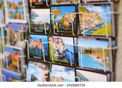 CORNIGLIA, ITALY - NOVEMBER 20, 2018: Various postcards from Cinque Terre displayed at souvenir shop