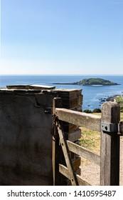 Cornish Coastal Path gate with view of Looe Island St Georges