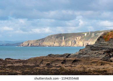 Cornish landscape in light and shadow. Rocky outcrops of land are a feature of the coastline of Cornwall.