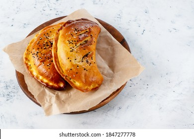 Cornish pasta is a pie with stews, potatoes, cabbage, and spices, including parsley, parsnips and rutabagas. Cornish pasty is a traditional English dish. Selective focus.