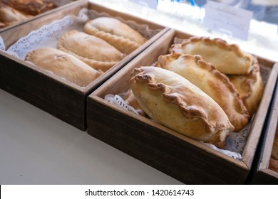 Cornish pasty in bakers shop. A favourite british snack, the pasty is originally from Cornwall and is enjoyed by holidaymakers.