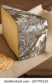 Cornish Yarg Cheese semi-hard cheese wrapped in nettle leaves made in Cornwall England