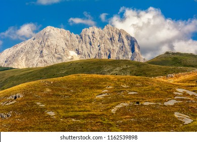 Corno Grande Mountain Seen from below with clouds around it Campo Imperatore - Abruzzo - Italy