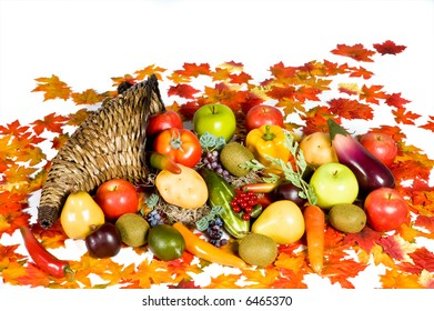 Cornucopia overflowing with fruits and vegetables over white background