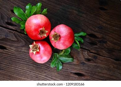 cornucopia with pomegranates and on wood background - vintage