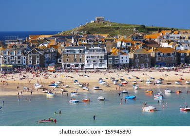 CORNWALL - AUGUST 4: The seaside village of St. Ives in Cornwall, England on August 4, 2011. Tourism comprises 24% of Cornwall's gross domestic product.