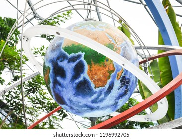 Cornwall, England - July 16, 2018: Miniature Earth planet inside the biomes of the Eden Project, a popular visitor attraction in Cornwall and home of the largest indoor rainforest in the world