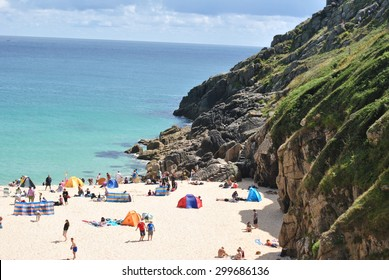 CORNWALL, ENGLAND- July 22, 2015: busy Porthcurno Beach in the lovely summer day, minutes walk from Minack Theater