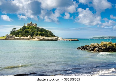 Cornwall summer. St Michael's Mount in Cornwall UK sailboats in the ocean bay. Beautiful destination. Travel vacation concept. Cornish vista. Cornwall tourism. Castle on an island.