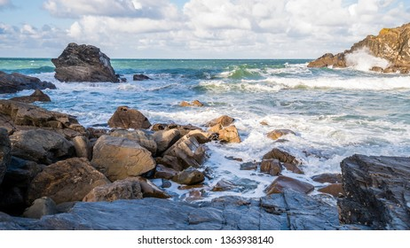 Cornwall/England UK - 11.04.2017:  A fresh bright and breezy day in a quiet rocky cove on the North Cornish coast with waves and surf.