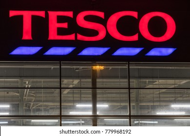 Cornwall,UK - December 18th 2017:Tesco supermarket neon sign above the thriving supermarket in Helston at night
