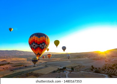 Coroful Hot Air Ballon Flying In The Deep Blue Sky.Turkey,Cappadocia.