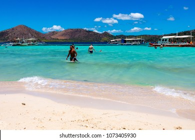 Coron Palawan Philippines April 12, 2018 Holidaymakers enjoying the sun and sea on the pink coral sand of CYC beach