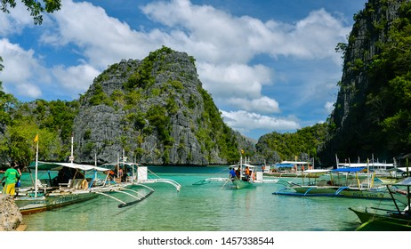 Coron, Palawan/PH - Dec. 21, 2012: Outrigger boats ferry tourists in Coron, Palawan, Philippines.