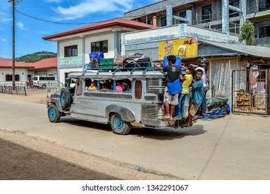 Coron, Palawan/PH - Dec. 22, 2012: Overloaded jeepney (mini-bus), a typical sight in rural Philippines.
