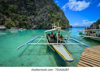 Coron, Philippines - Apr 9, 2017. Wooden boats docking on Coron Island, Philippines. Coron is known for several Japanese shipwrecks of World War II vintage.