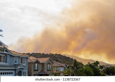 Corona, CA USA - July 19, 2018:A wildfire burns and smoke rises in the forest near homes on the south city border close to the Cleveland National Forest.