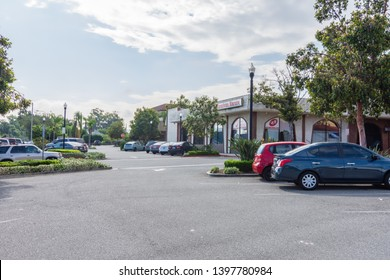 Corona, CA USA - May 11, 2019: Main street mall area in center of city with local business and shops. Parking lot with karate business near parking entrance.