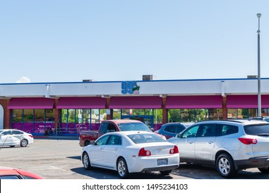 Corona, CA USA - September 3, 2019: Main street area in center of city with access to local small businesses, services, and churches. 99 cent store in older area of city.