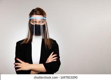 Corona virus concept. Woman businessman posing with mask.