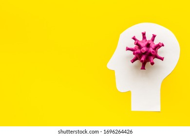 Corona virus Covid-19 - diagnostics concept with strain virus model and human's head - on yellow background top-down copy space