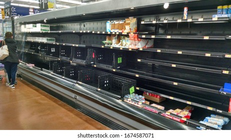 Corona virus COVID-19 scare and panic Shelves empty of drinking water, eggs, toilet paper and paper towels at Walmart Fort Wright Northern Kentucky USA March 10 2020 Editorial photography