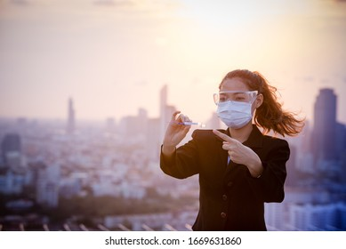 Corona virus, or Covid-19, is spreading all over the world.Asian girls scientist works in modern biological lab, Covid-19 is currently trying to find a drug against the virus to treat the infected.
