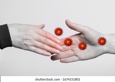 Corona virus infects through a close-up handshake. Concept of the spread of a pandemic virus.
