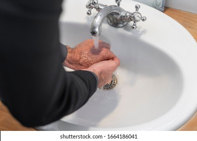 Corona Virus. Man clean his hands to protect and take care of his health. Protect workplace. Clean usually your hands. Business man cleaning hands.