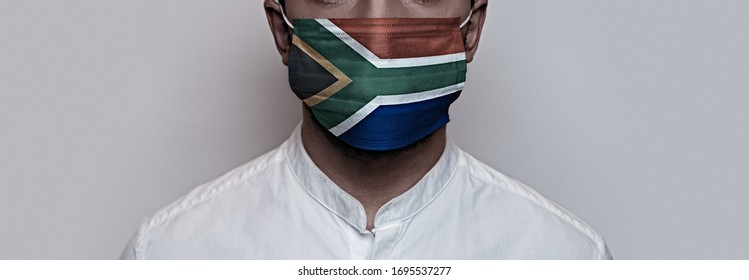 Corona virus pandemic. Concept of Corona virus quarantine, Covid-19. The male face is covered with a protective medical mask, painted in South Africa flag colors