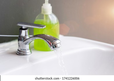Corona virus preventive concept, soap gel and water tap washing hands to protect the virus.  Healthcare conception.