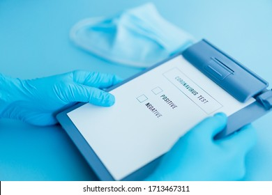 corona virus test result document on blue background with doctor blue gloves and mask