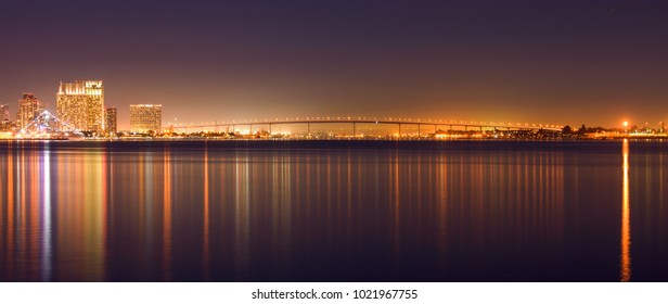 Coronado Bridge at Night - A panoramic night view of Coronado Bridge, connecting San Diego Downtown and Coronado Peninsula, crossing over San Diego Bay. San Diego, California, USA.