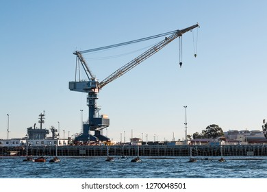CORONADO, CALIFORNIA - MARCH 2, 2017:  A crane used to load Naval Vessels at Naval Air Station North Island on San Diego bay.
