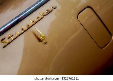 Coronado, California / United States - April 5, 2016: The emblem of a 1957  Studebaker Golden Hawk.