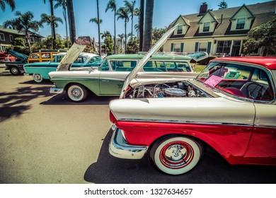 Coronado, California / United States – April 24, 2016: The 1957 Ford Ranchero and Ranch Wagon with a 1956 Nash Ambassador Custom 8 lined up at Motorcars on Mainstreet.