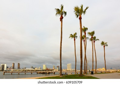 Coronado, San Diego, California - May 9, 2017: Centennial Park with San Diego city skyline in the background at Sunset. The park is on the island of Coronado with beaches,and walking paths
