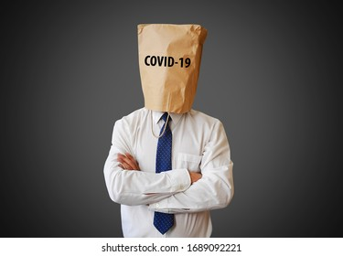 Coronavirus and businessman with paper bag on his head