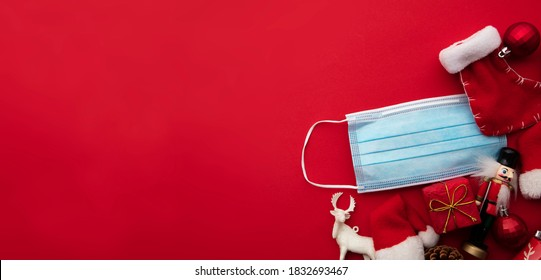 Coronavirus Christmas background. Face mask and festive decorations - Shutterstock ID 1832693467