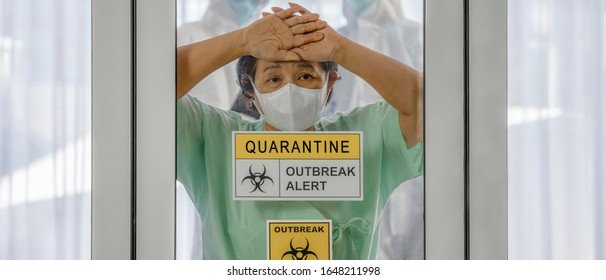 coronavirus covid 19 infected patient in coronavirus covid 19 quarantine room with quarantine and outbreak alert sign at hospital with blurred disease control experts, coronavirus outbreak control