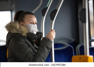 Coronavirus, covid 2019, young woman with respiratory mask traveling in the public transport by bus - Shutterstock ID 1657907284