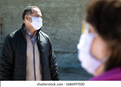 Coronavirus, covid Social distancing concept. Two mask  people talking keeping security distance, wearing protection mask for coronavirus or covid-19 virus outbreak in a city. Corona  virus outbreaks.