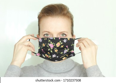 Coronavirus, COVID-19,  2019-nCoV concept. Woman with homemade cotton+microfiber face mask. Woman putting on or taking off face mask.