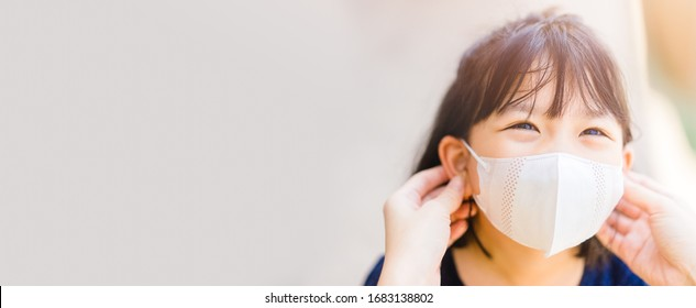 Coronavirus Covid-19 and Air pollution concept.Asian girl and mother wearing mask.Back to school.New normal post covid-19.Reopen school and infected like kawasaki disease.Banner background.School kid.