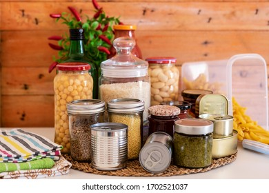 Coronavirus Covid-19 infection. Food supplies  for quarantine isolation period. Different glass jars with grains, legumes, jams, pasta, cans of canned food