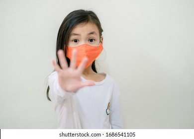 Coronavirus Covid-19 virus and Air pollution pm2.5.Asian child girl  protect from virus stop coronavirus covid 19 outbreak.Child girl activity stay at home.